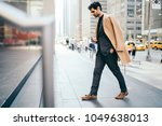 thoughtful handsome male owner... | Shutterstock . vector #1049638013