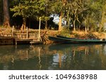 small boat among the floating... | Shutterstock . vector #1049638988