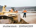 surveyor engineer with gps... | Shutterstock . vector #1049642309