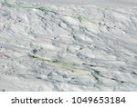 Small photo of kite used to make snowkite in snow, waiting to take off, detail of cables or ropes, in dacron, high mountains, extreme sport, Alps, Devero Valley, Piedmont, Italy
