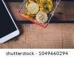 basket of crypto currency... | Shutterstock . vector #1049660294