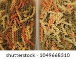 three color spiral twist pasta  ... | Shutterstock . vector #1049668310