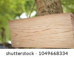 empty wooden plate with blank... | Shutterstock . vector #1049668334