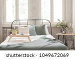 interior of white and gray cozy ... | Shutterstock . vector #1049672069