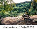 mountain biker riding on bike... | Shutterstock . vector #1049672090