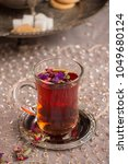 Small photo of Red tea with herbs and flowers