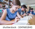 group of students engaged in... | Shutterstock . vector #1049681840