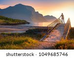 landscape at sunset with beach...   Shutterstock . vector #1049685746