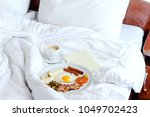 breakfast in the bed of the... | Shutterstock . vector #1049702423
