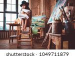 young woman painter in her... | Shutterstock . vector #1049711879
