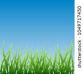 green grass over blue sky... | Shutterstock .eps vector #1049717450