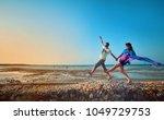 happy young couple having beach ... | Shutterstock . vector #1049729753