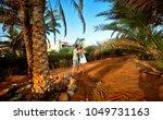 happy young couple having beach ... | Shutterstock . vector #1049731163