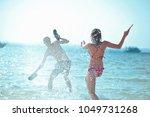 happy young couple having beach ... | Shutterstock . vector #1049731268