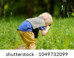 charming kid exploring nature... | Shutterstock . vector #1049732099