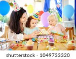 little child and their mother... | Shutterstock . vector #1049733320