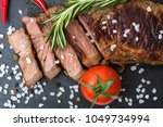 top view of a sliced roasted... | Shutterstock . vector #1049734994