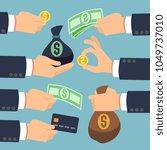 mans hand holding cash  coins ... | Shutterstock .eps vector #1049737010