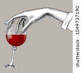 woman's hand holding a glass... | Shutterstock .eps vector #1049737190
