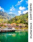 port in old town kotor ... | Shutterstock . vector #1049738990