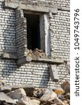 an abandoned house collapses in ... | Shutterstock . vector #1049743796