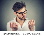 young serious man with... | Shutterstock . vector #1049763146