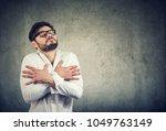 young man in eyeglasses in love ...   Shutterstock . vector #1049763149