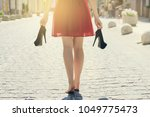 elegant girl in red dress with... | Shutterstock . vector #1049775473