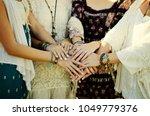 four boho style women from...   Shutterstock . vector #1049779376