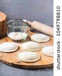 raw big dumplings on wooden... | Shutterstock . vector #1049798810