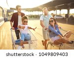 group of happy young people... | Shutterstock . vector #1049809403