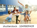 group of happy young people... | Shutterstock . vector #1049809439
