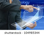 Business people drawing a graph by finger on glass laptop touch screen. - stock photo