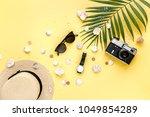 traveler accessories on yellow... | Shutterstock . vector #1049854289