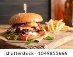 tasty burger with bacon and... | Shutterstock . vector #1049855666