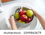 Young Woman Washing Ripe Apples ...