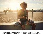 fit african american skater... | Shutterstock . vector #1049870636
