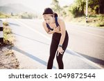 Small photo of Woman chest pain while jogging