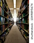 Small photo of Blurred Books in Library doctrine window light for background, Companionway