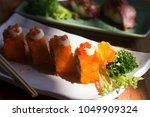 california maki sushi in a... | Shutterstock . vector #1049909324