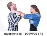 Small photo of Married couple problems, wife choking her husband, furious with him