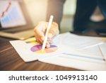 side view shot of a man's hands ... | Shutterstock . vector #1049913140