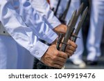 Small photo of Navy officer in summer white uniform hold M16 rifle with bayonet preparing for salute VIP.