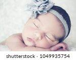 closeup portrait of one week...   Shutterstock . vector #1049935754