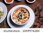 tortilla soup   sopa de tortilla | Shutterstock . vector #1049976284