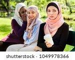 islamic women gossiping and...   Shutterstock . vector #1049978366