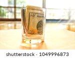 soft focus bank of 10 us... | Shutterstock . vector #1049996873