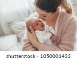 home portrait of a newborn baby ... | Shutterstock . vector #1050001433