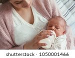 home portrait of a newborn baby ... | Shutterstock . vector #1050001466