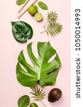 tropical fruits and leaves on... | Shutterstock . vector #1050014993